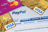 Online shopping paid via Paypal payments using plastic cards Vi — Stock Photo