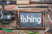 Blackboard and other fishing accessories — Stock Photo