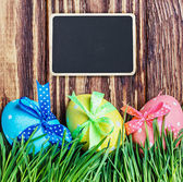 Blackboard for the text and Easter egg — Stock Photo