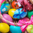Easter eggs in brown basket — Stock Photo #43186335