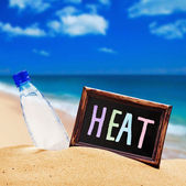 Blackboard with the text of the heat and water bottle  — Stock Photo