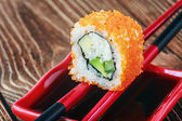 Japanese rolls on sticks with sauce  — Stock Photo