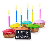 Colorful happy birthday cupcakes with candles  — Stock Photo