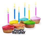 Birthday cupcakes in different colors — Stock Photo