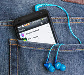 HTC Mobile Phone in a jeans pocket — Stock Photo