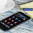 HTC Mobile Phone with Android applications on the desktop — Stock Photo #44963457