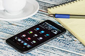HTC Mobile Phone with Android applications on the desktop — Foto Stock