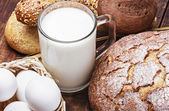 Bread, milk, flour and eggs   — Stockfoto