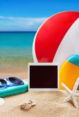 Photoframe and beach gear   — Stock Photo