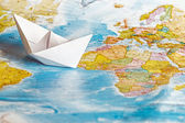 Paper ship on map — Stock Photo