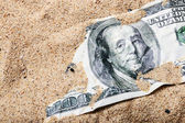 100 dollar bill buried in the sand — Stock Photo