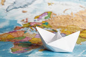 Ship from a paper on the geographical   — Stock Photo