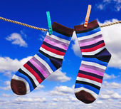 Colorful socks hanging on clothespins  — Stock Photo