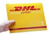 Hand holding Envelope logo DHL — Stock Photo