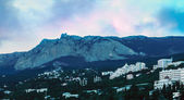Sunset over night Yalta and Ai-Petri Mountain — Stock Photo