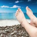 Man's legs on the sand beach — Stock Photo #49171895