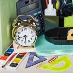 Alarm clocks and school supplies — Stock Photo #49171941