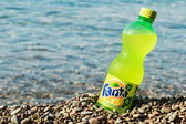 Fanta bottle on the beach — Stock Photo