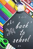 Written on the blackboard back to school — Stockfoto