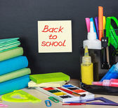 Words back to school and stationery — Stock Photo