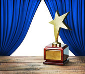 Star award and blue curtains with space for text — Stock Photo