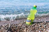 Fanta bottle on the beach — Stock Photo