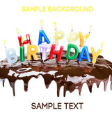 Lighted candles on a birthday cake — Stock Photo