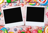 Picture frame lies on candies — Stock Photo