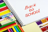 Notepad with back to school — Stock Photo