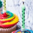 Burning candles on cupcakes — Stock Photo