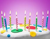 Burning candles on a birthday cake   — Stock Photo