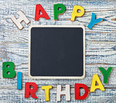 Black board for writing congratulations letters   — Stock Photo