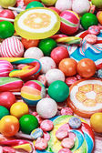 Multicolored lollipops and chewing gums — Stock Photo