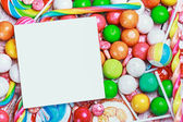 White sheet on candy and sweets — Stock Photo