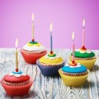 Birthday cupcakes with burning candles — Stock Photo #51442959