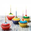 Birthday cupcakes with burning candles — Stock Photo #51442961
