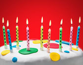 Burning candles on a birthday cake   — Stock Photo