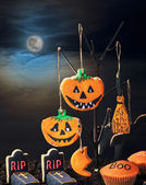 Halloween cookies hanging on a tree  — Stock Photo