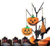 Cookies for Halloween hanging on a tree — Stock Photo