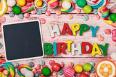 Blackboard for congratulations letters of cookies — Stock Photo