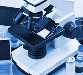 Microscope and biological reagents  — Stock Photo