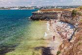 Tourists basking on a wild Chersone beach — Stock Photo