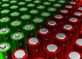 Opposition rows of red and green alkaline batteries (AA) — Stock Photo