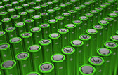 Rows of green alkaline batteries (AA) — Stock Photo