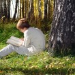 Stock Photo: Boy reading outdoor
