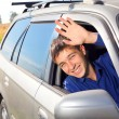 Young man in a car — Stock Photo