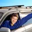 Young man in a car — Stockfoto