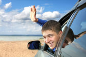 Young man in a car — Foto Stock