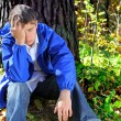 Stock Photo: Sorrowful young man