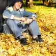 Teenager in autumn park — Stock Photo #12338692